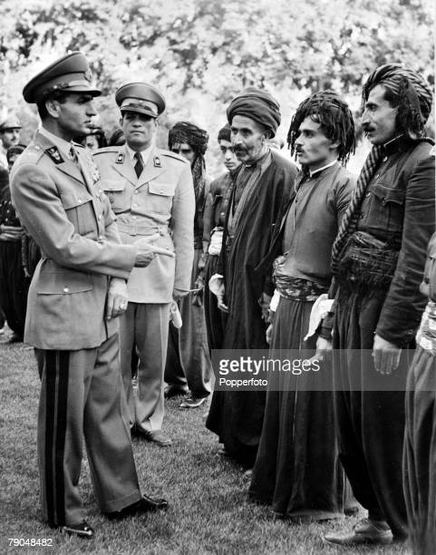 circa 1940's The Shah of Iran Muhammad Reza Pahlavi speaking with tribal chiefs He ascended the throne in 1941 narrowly escaped assasination in 1949...