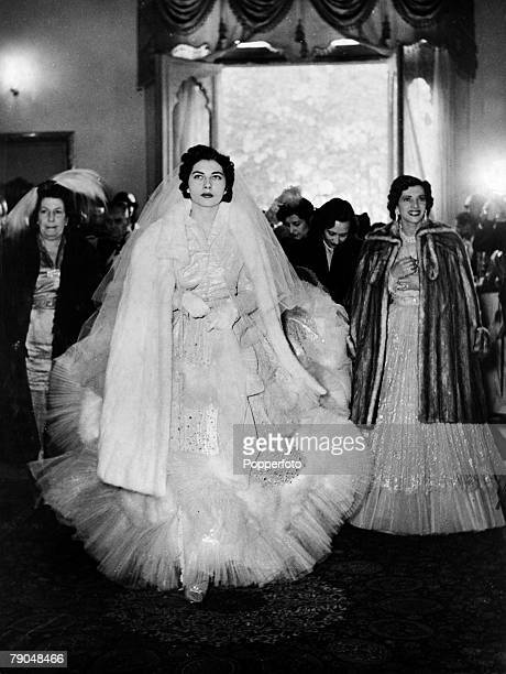 February 1951 Soraya Esfandiari who was to become the second wife of the Shah pictured in her Dior wedding dress before the ceremony in the Hall of...