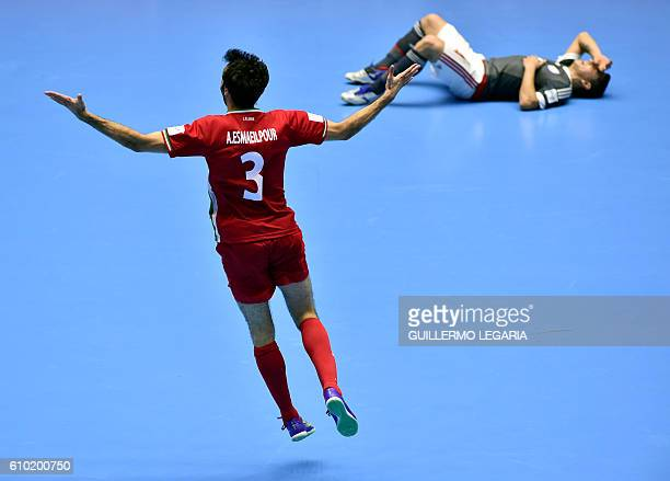 Iran 's Ahmad Esmaeilpour celebrates his team's victory over Paraguay during their Colombia 2016 FIFA Futsal World Cup quaterfinal match in...