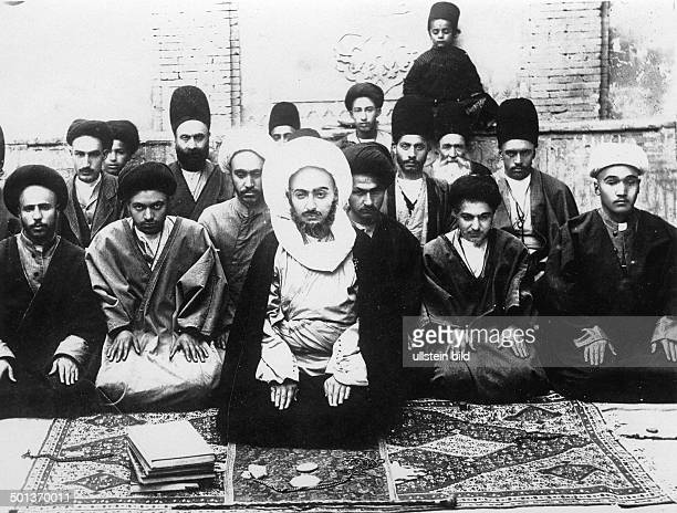 Iran Shiite cleric praying together with his relatives and servants probably in the 1910s
