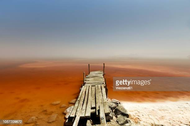 iran, west azerbaijan, urmia, urmia salt lake, wooden pier - lake urmia foto e immagini stock