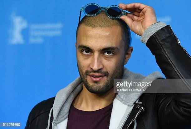 Iranian actor Amir Jadidi poses during a photocall for the film 'Ejhdeha Vared Mishavad' in competition of the 66th Film Festival Berlinale in Berlin...