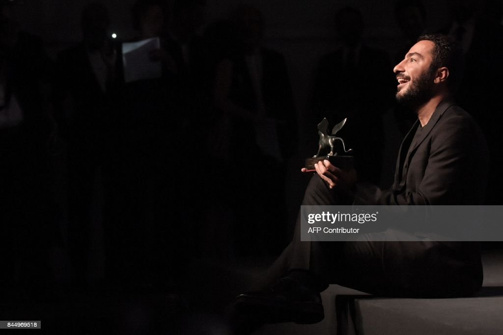 Iranian actor Navid Mohammadzadeh poses during a photocall after he receives the Orizzonti Award for Best Actor for his character in the movie 'No Date, No Signature' (Bedoune Tarikh, Bedoune Emza) during the award ceremony of the 74th Venice Film Festival on September 9, 2017 at Venice Lido. / AFP PHOTO / Tiziana FABI