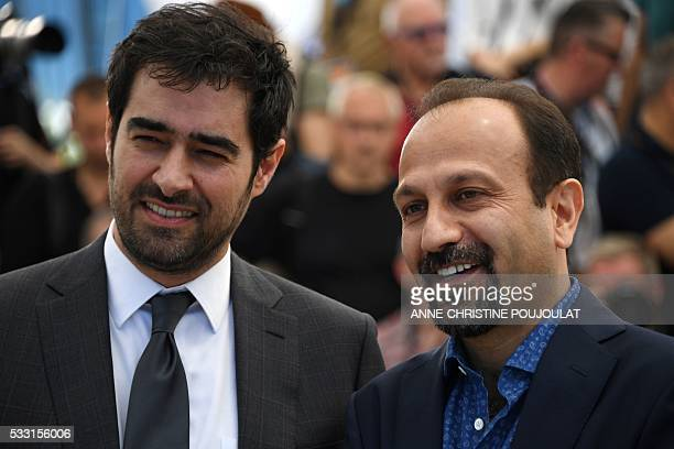 Iranian actor Shahab Hosseini and Iranian director Asghar Farhadi pose on May 21 2016 during a photocall for the film The Salesman at the 69th Cannes...