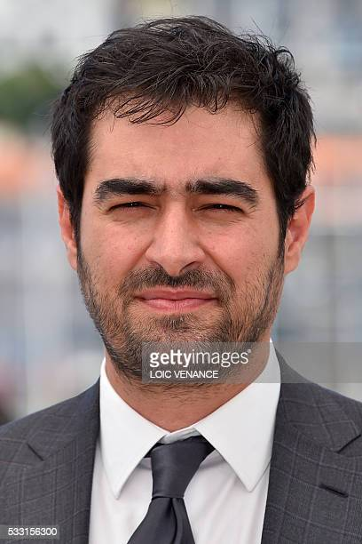 Iranian actor Shahab Hosseini poses on May 21 2016 during a photocall for the film The Salesman at the 69th Cannes Film Festival in Cannes southern...
