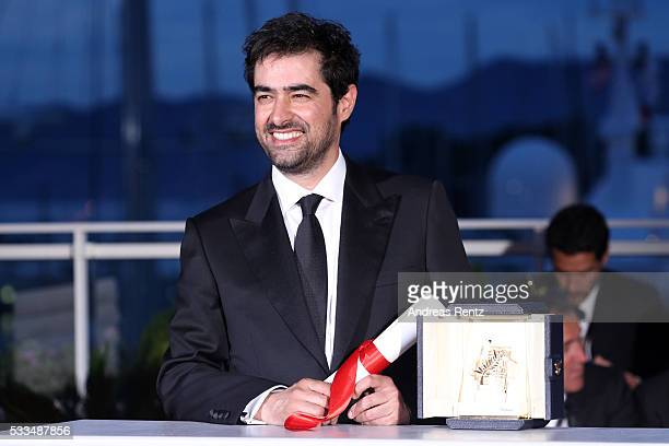 Iranian actor Shahab Hosseini poses with the award for Best Actor for the movie 'The Salesman' at the Palme D'Or Winner Photocall during the 69th...