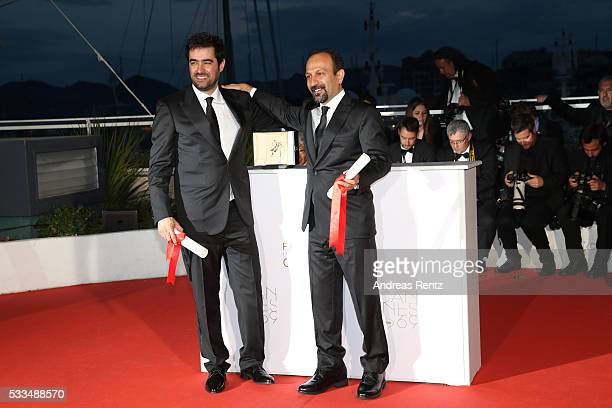 Iranian actor Shahab Hosseini poses with the award for Best Actor for the movie 'The Salesman' and Iranian director Asghar Farhadi poses with his...