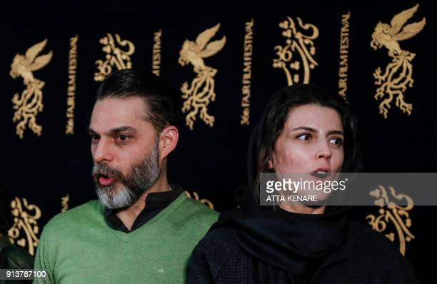 Iranian actress and director Leila Hatami poses for a picture with IranianAmerican actor and director Peyman Moaadi as they arrive for a film...