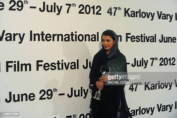 Iranian actress Leila Hatami poses with the Crystal Globe Award for best actess for her role in the film ''The last step'' at the 47th Karlovy Vary...
