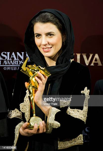 Iranian actress Leila Hatami receives the Best Director award on behalf of Iranian filmmaker Asghar Farhadi for the film 'A Separation' during the...