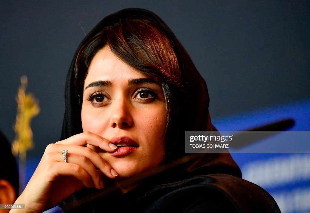 Iranian actress Parinaz Izadyar attends a press conference to present the film 'Pig' (Khook) presented in competition during the 68th edition of the Berlinale film festival in Berlin on February 21, 2018. / AFP PHOTO / Tobias SCHWARZ