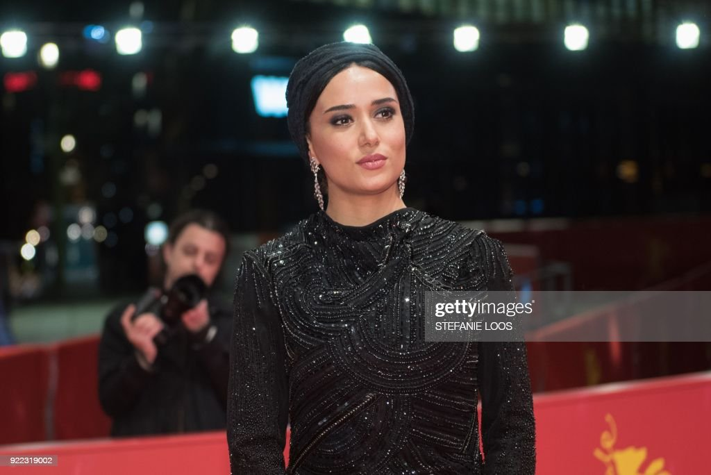 Iranian actress Parinaz Izadyar poses on the red carpet before the premiere of the film 'Pig' (Khook) presented in competition during the 68th edition of the Berlinale film festival in Berlin on February 21, 2018. / AFP PHOTO / Stefanie Loos