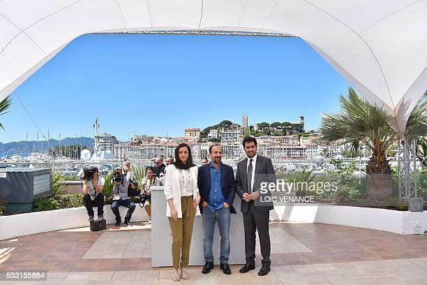 Iranian actress Taraneh Alidoosti Iranian director Asghar Farhadi and Iranian actor Shahab Hosseini pose on May 21 2016 during a photocall for the...