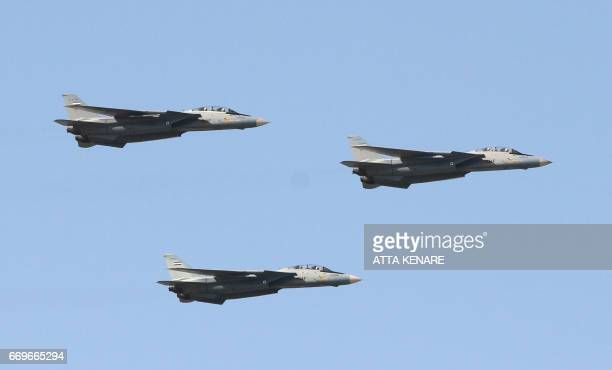 Iranian air force's USmade F14 fighter jets perform during a parade on the occasion of the country's Army Day on April 18 in Tehran / AFP PHOTO /...