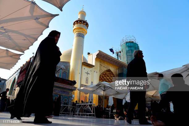 Iranian and Afghan Shiite Muslim pilgrims gather in the courtyard of the Imam Ali Shrine on October 18 2019 in the shrine city of Najaf in central...