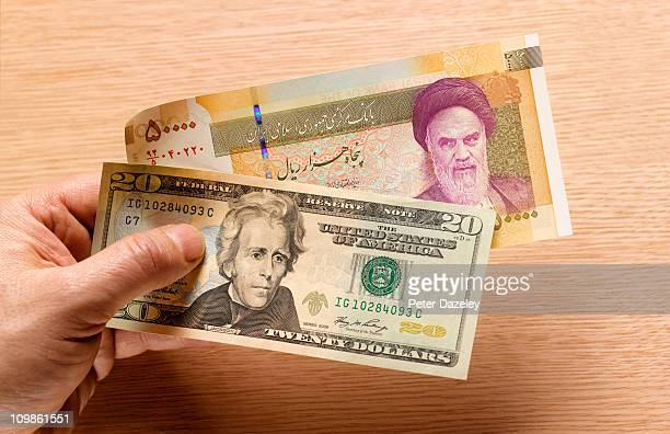 iranian and us bank notes - iran stock pictures, royalty-free photos & images