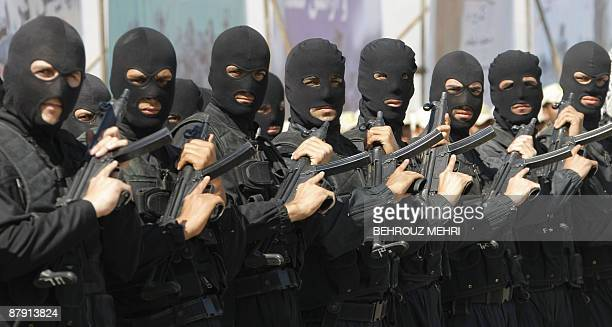 Iranian antinarcotics police special forces hold their guns during a drill at a ceremony concluding manoeuvres agaisnt drug smuggling in Iran's...