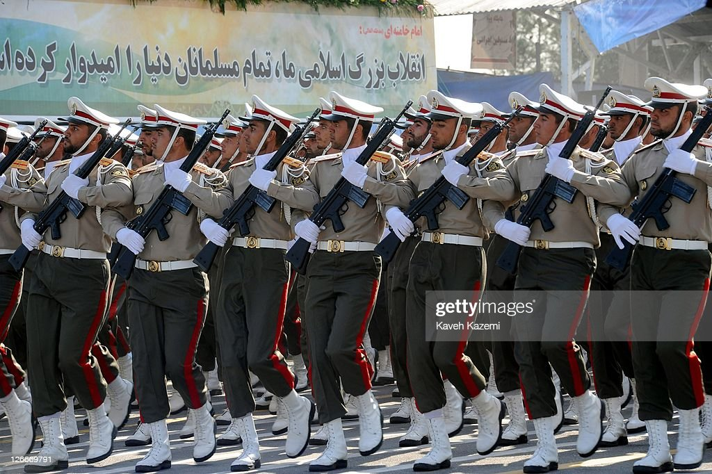 Iranian armed forces march during a parade commemorating the 31st anniversary of Iran-Iraq war on September 22, 2011 in Tehran, Iran. Iran is holding military parades in Tehran and other parts of the country on the first day of the Sacred Defence Week. Tehran's parade began to the north of Imam Khomeini's mausoleum providing the army, Islamic Revolution Guards Corps, Law Enforcement Force and Basij with an opportunity to display their state of military preparedness, in which armaments and indigenously built military equipment including Shahab missiles, unmanned aircrafts, Zulfaqar tanks, and a variety of rapid fire machine guns were showcased.