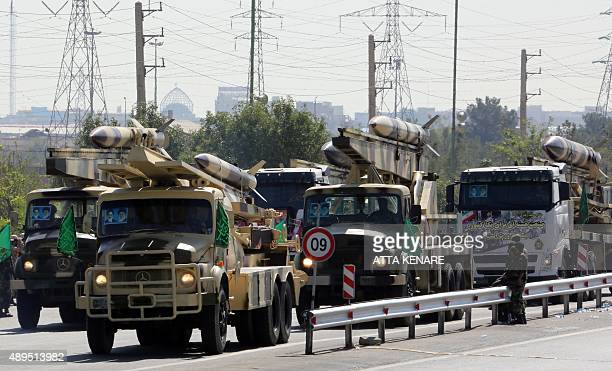 Iranian army trucks carry missiles during the annual military parade marking the anniversary of the start of Iran's 19801988 war with Iraq on...
