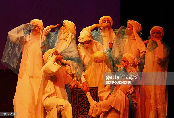 Iranian artists perform a scene from the Islamic story of Ashura during a musical to commemorate the anniversary of the IranIraq war at Vahdat hall...