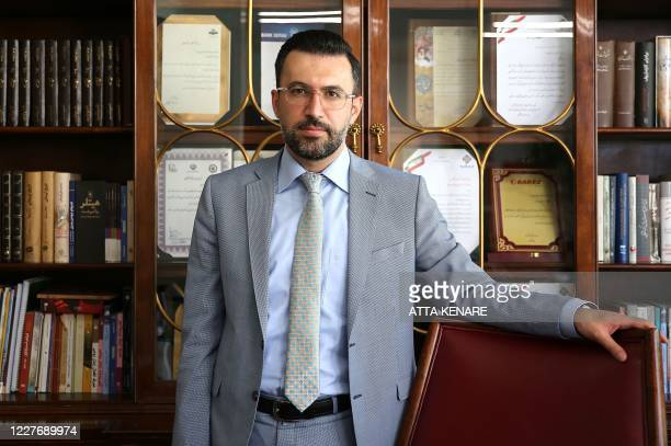 Iranian Babak Paknia the lawyer of Amirhossein Moradi one of the three people convicted over November protests speaks during an interview with AFP at...