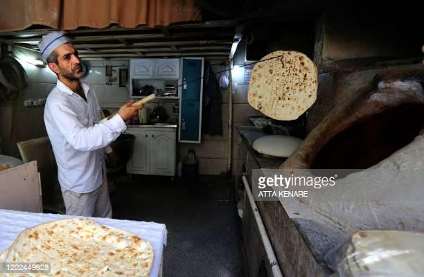 Iranian baker Mohammad Mirzakhani makes Taftoon bread in Tehran on June 13, 2020.