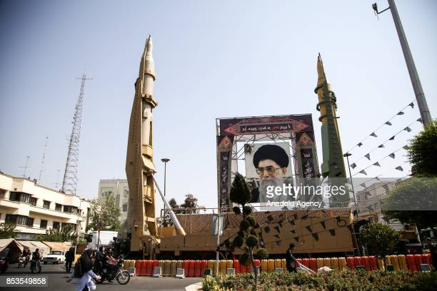 Iranian ballistic missiles Sejjil and QadrH are on display at Baharestan Square on the occasion of the Iranian Defense Week in Tehran Iran on...