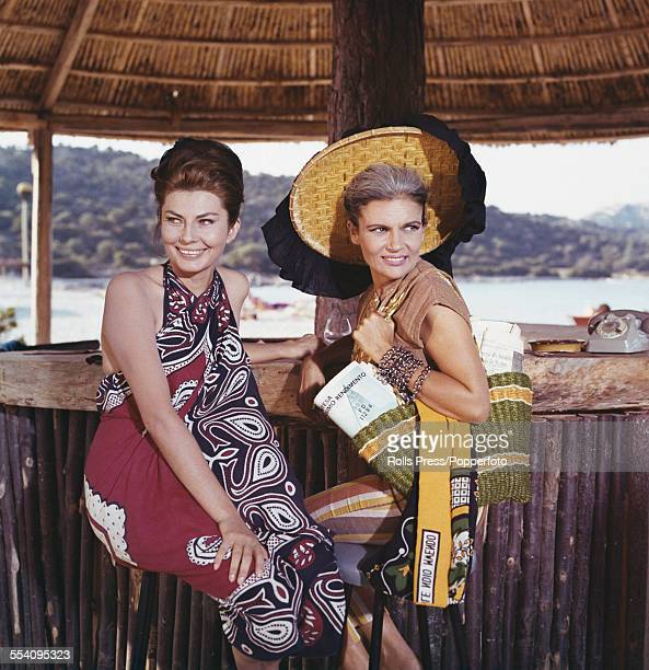 Iranian born actress and second wife of Mohammad Reza Pahlavi Shah of Iran Soraya EsfandiaryBakhtiari pictured left with a friend at a beach side bar...