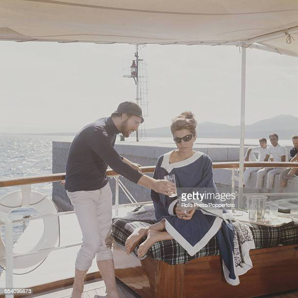 Iranian born actress and second wife of the Shah of Iran Soraya EsfandiaryBakhtiari with actor Richard Harris who play the roles of Linda and Robert...