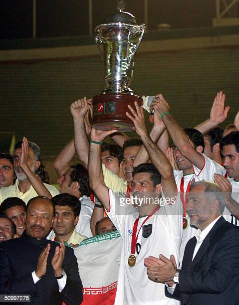 Iranian captain Ali Daei holds up the cup after Iran defeated Syria 41 in the final of the West Asian Football Federation Cup at Tehran's Azadi...