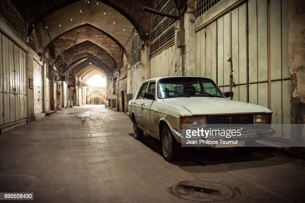 Iranian car parked in a Silent Alley of the Bazaar of Isfahan, Iran