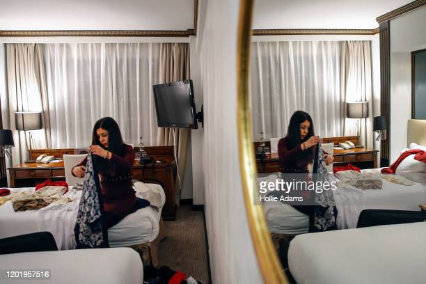 Iranian chess arbiter Shohreh Bayat folds headscarves at her hotel after appearing on BBC Newsnight at BBC studios on February 19 2020 in London...
