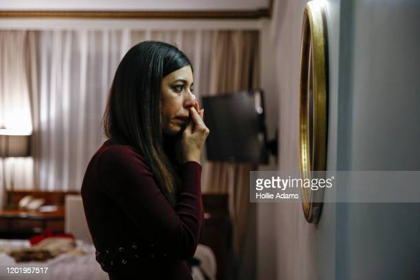 Iranian chess arbiter Shohreh Bayat wipes tears from her eyes at her hotel after her interview with Emily Maitlis on BBC Newsnight on February 19...