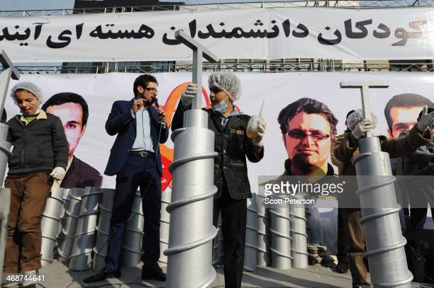 Iranian children build model centrifuges out of styrofoam and glue in a competition beneath a banner reading Nuclear scientists of the next...