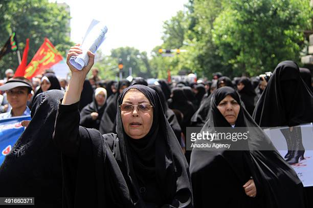 Iranian citizens hold placards during a demonstration at Palestine square in Tehran on May 16 2014 Iranians staged a rally on may 16 to demand that...