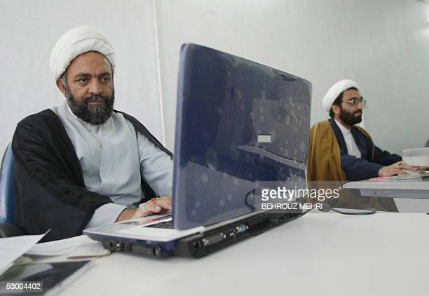 Iranian clergyman Nematollah Daneshmand webmaster for saneeiorg the site of Grand Ayatollah Yusuf Saanei works on his laptop at his office in Qom...