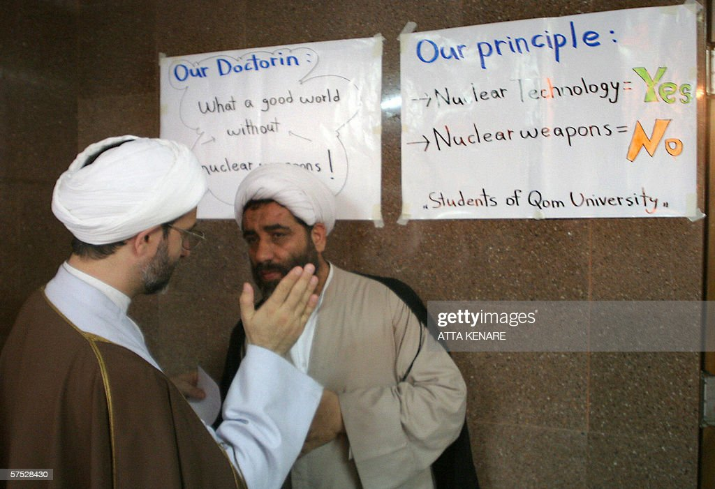 Iranian clergymen talk to each other during an exhibition of Iran's Atomic Energy Organization at the an university in the city of Qom, 130 kms south of the capital Tehran, 04 May 2006. Iran claimed today it had made more progress in ultra-sensitive nuclear work, showing yet more defiance in the face of Western lobbying for tough Security Council action.