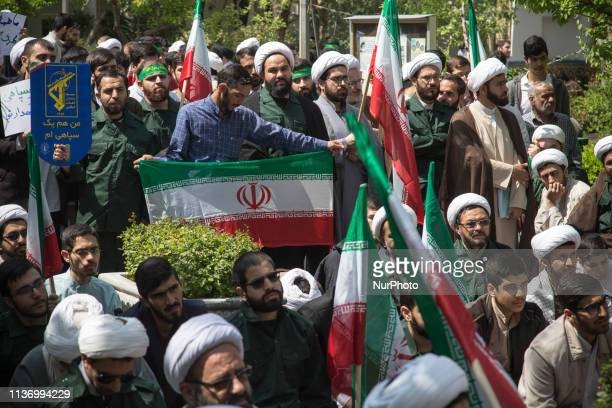 Iranian Clerics chant slogans during an anti-US rally in Tehran on April 14, 2019. The US government on 08 April 2019 said it had designated Iran's...