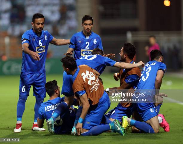 Iranian club Esteghlal's players celebrate after scoring a goal against Saudi club AlHilal during their Asian Champions League football match on...