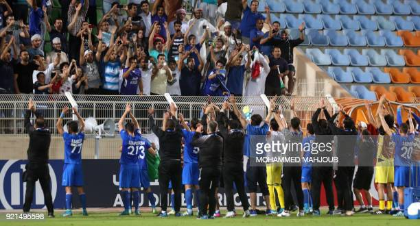Iranian club Esteghlal's players celebrate after winning against Saudi club AlHilal during their Asian Champions League football match on February 20...