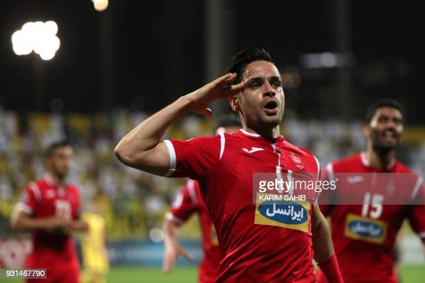 Iranian club Persepolis' player Alireza Beiranvand celebrates scoring against UAE's AlWasl club during their Asian Champions League football match...