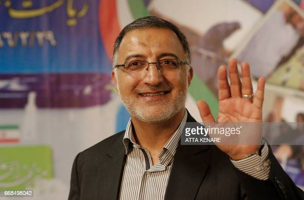 Iranian conservative presidential candidate, Alireza Zakani, waves after registering his candidacy for the upcoming presidential elections at the...