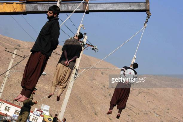 Iranian convicted rapists hang the gallows during a public execution in the southern city of Shiraz, 950 kms south of Tehran, 05 September 2007. Iran...