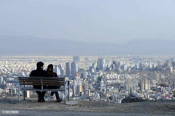 Iranian couple in in the roof of Tehran