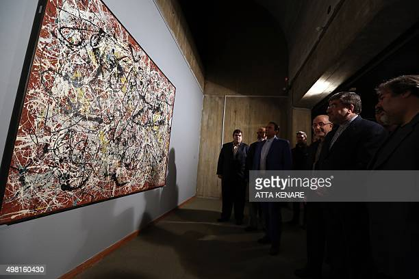 """Iranian Culture Minister Ali Jannati looks at US artist Jackson Pollock's """"Mural on Indian Red Ground"""" during the opening ceremony of an exhibition..."""
