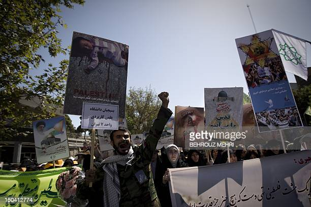 Iranian demonstrators chant slogans during the 'Quds Day' rally an antiIsraeli demonstration in solidarity with Palestinians in Tehran on August 17...