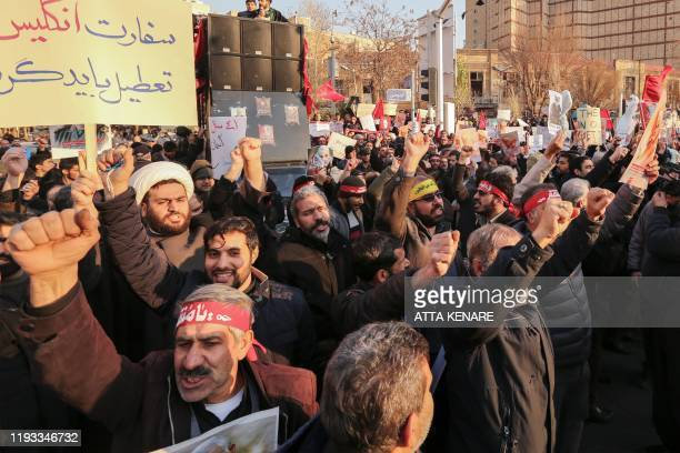 Iranian demonstrators hold placards and chant anti-Britain slogans in front of the British embassy in the capital Tehran on January 12, 2020...