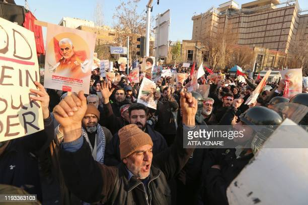 Iranian demonstrators hold placards bearing the image of slain military commander Qasem Soleimani in front of the British embassy in the capital...