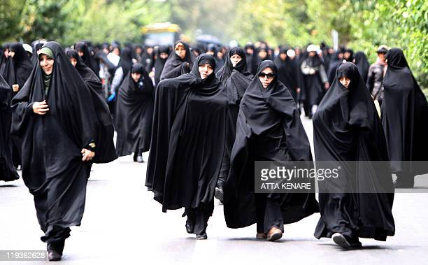 Iranian demonstrators march after weekly Friday prayers in Tehran on July 8 2011 during a protest asking the government to intensify its crackdown on...