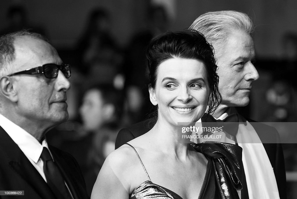 Iranian director Abbas Kiarostami, French actress Juliette Binoche and British actor William Shimell arrive for the screening of 'Copie Conforme (Certified Copy) presented in competition at the 63rd Cannes Film Festival on May 18, 2010 in Cannes.